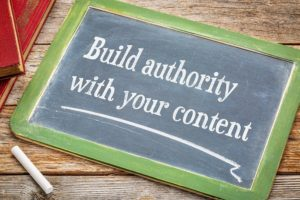 A chalkboard describing how important it is to build SEO authority with your content.