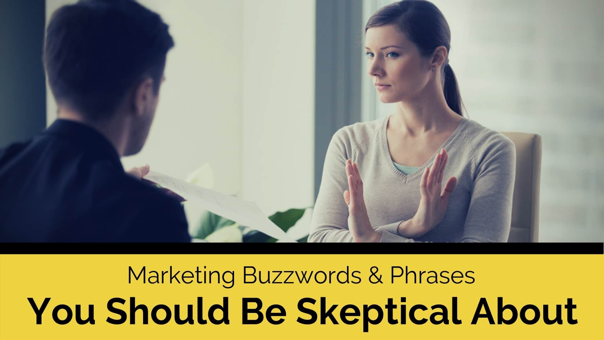 woman listening to a man say marketing buzzwords